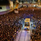 Hong Kong leader apologises as rally chokes city