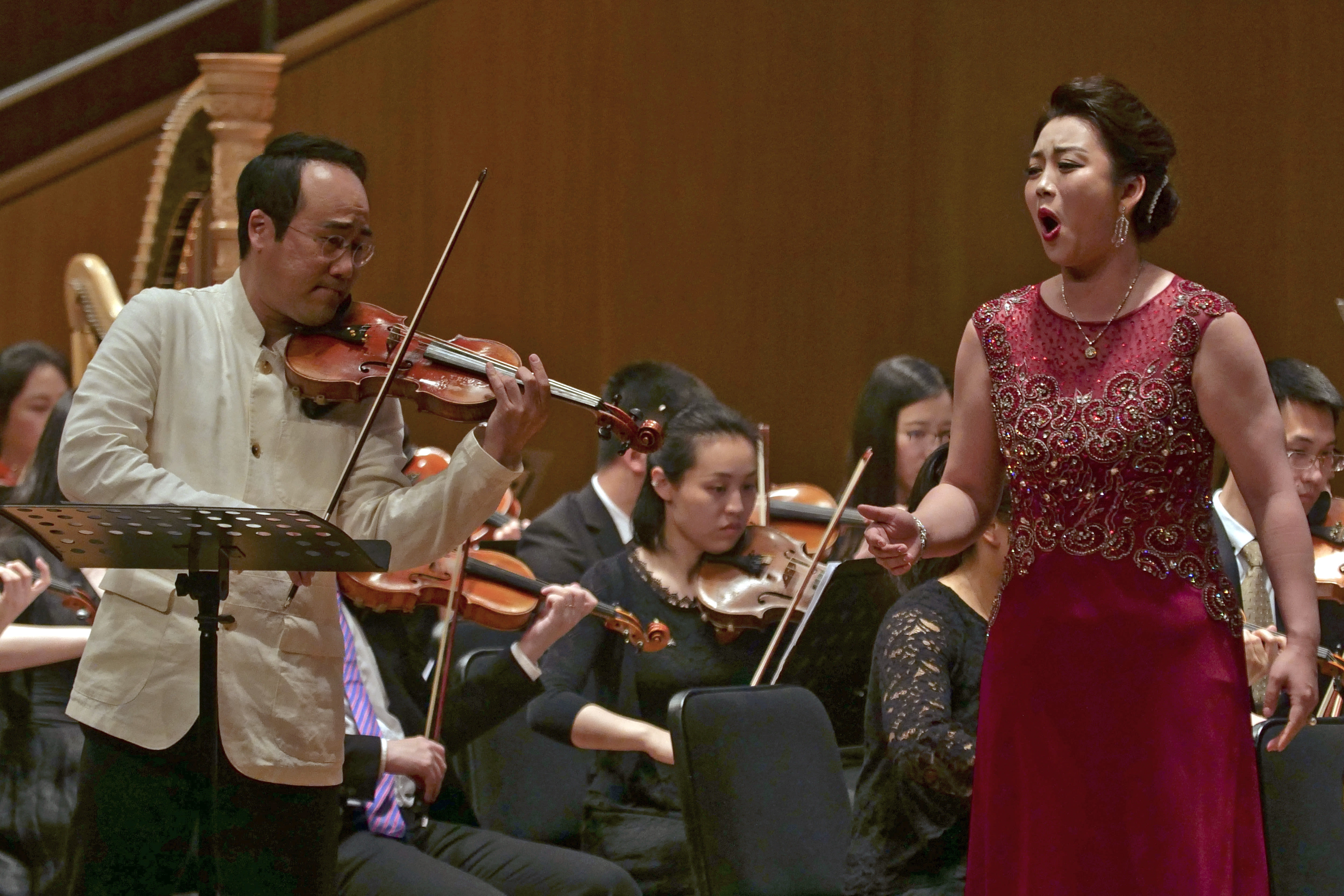 In this Sunday, May 12, 2019, file photo, South Korean violinist Won Hyung Joon and his North Korean soprano partner Kim Song Mi perform at the Shanghai Oriental Arts Center in Shanghai. Won, a South Korean, performed together with Kim, a North Korean, in a rare joint performance they hope would help bring the divided Koreas closer together via music. Their performance comes three days after North Korea fired two suspected short-range missiles in the second such weapons test in five days. (AP Photo/Dake Kang, File)
