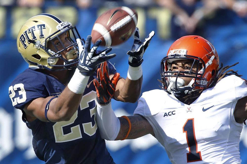 Pittsburgh wide receiver Tyler Boyd (23) makes a catch in front of Virginia cornerback Demetrious Nicholson (1) in the second quarter of an NCAA college football game Saturday, Sept. 28, 2013, in Pittsburgh. Pittsburgh won 14-3