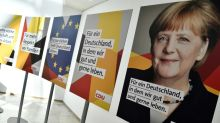 Merkel waves flag in election battle against populists