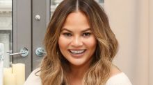 Leave it to Chrissy Teigen to politely troll the 2018 Met Gala from the comforts of her own couch