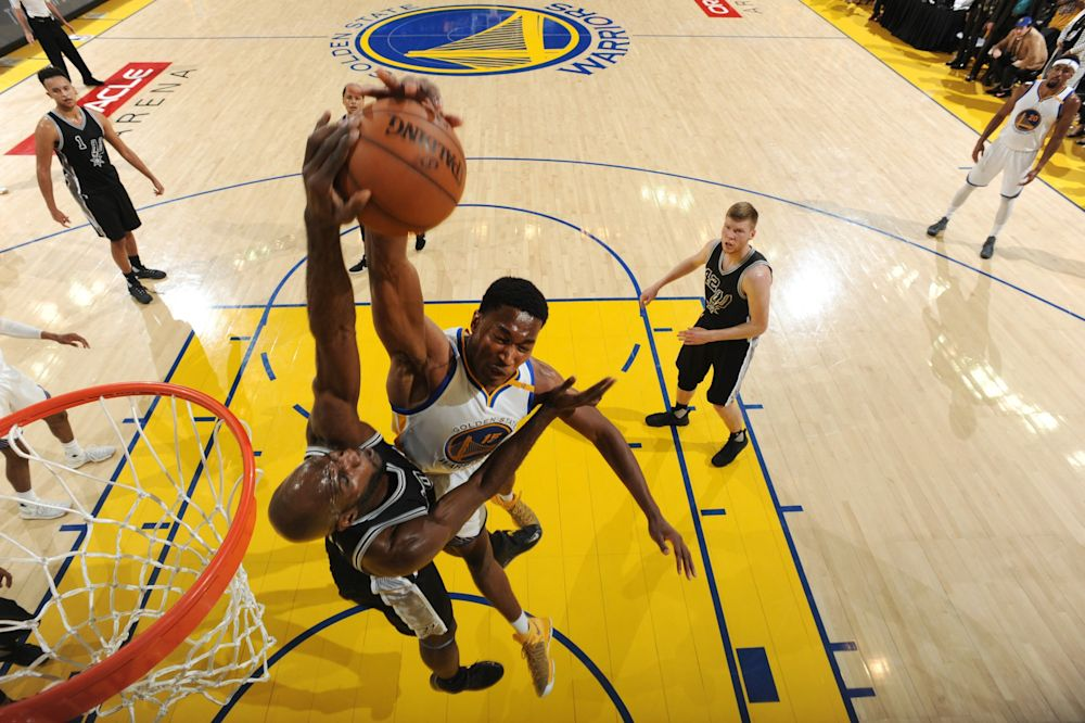 Joel Anthony, who is still in the NBA, blocks a dunk attempt by Golden State's Damian Jones late in Game 2. (Andrew D. Bernstein/NBAE/Getty Images)