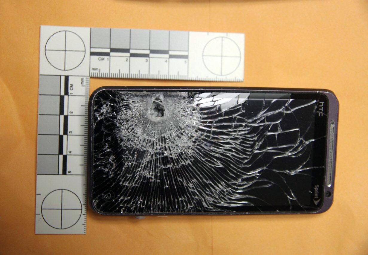 Fla police: Cellphone stops bullet fired by robber