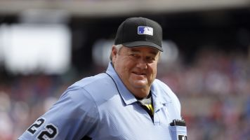 MLB fans rain on umpire Joe West's parade