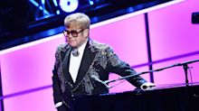 Elton John performs at Meghan and Harry's lunchtime reception