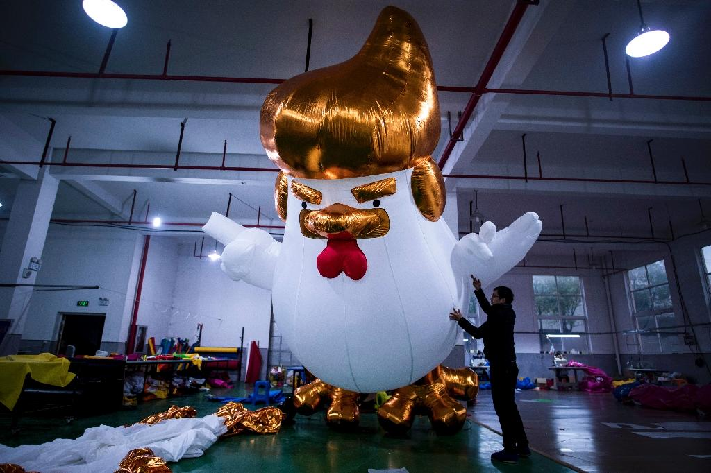 A golden mane and tiny wings that mimic his hand gestures -- the resemblence of inflatable chickens produced for the Chinese New Year to US President-elect is unmistakable