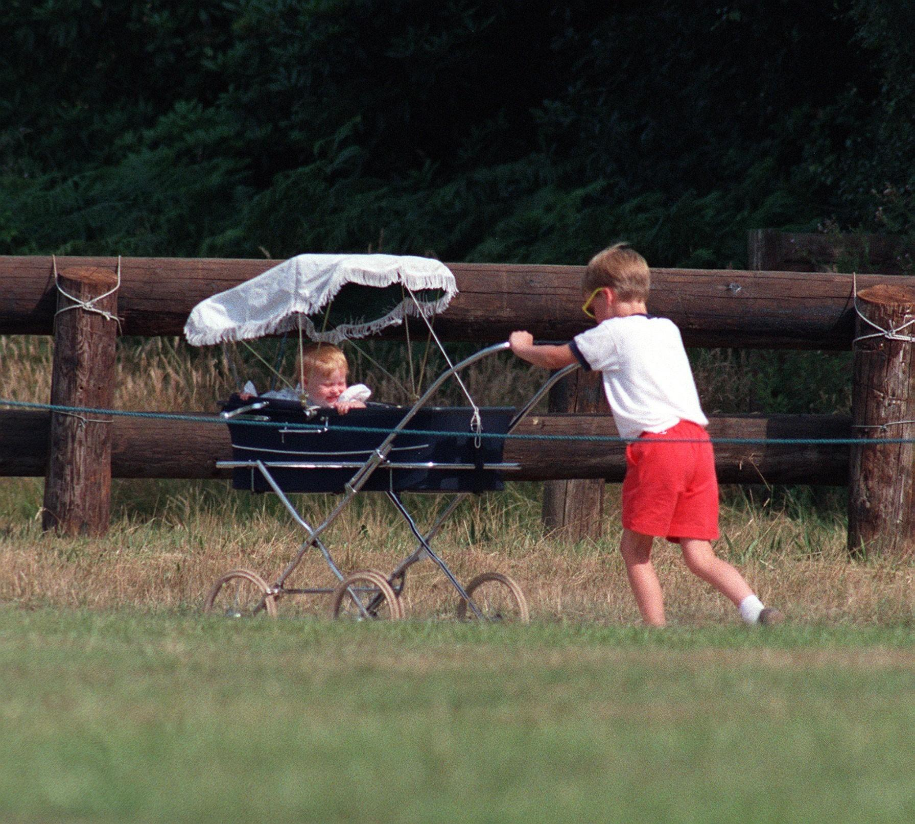 Prince William Collection 1989 Prince William pushing Princess Beatrice in pram, July 1989 Princess Beatrice in pram being pushed by her cousin Prince William. (Photo by Dennis James /Mirrorpix/Getty Images)