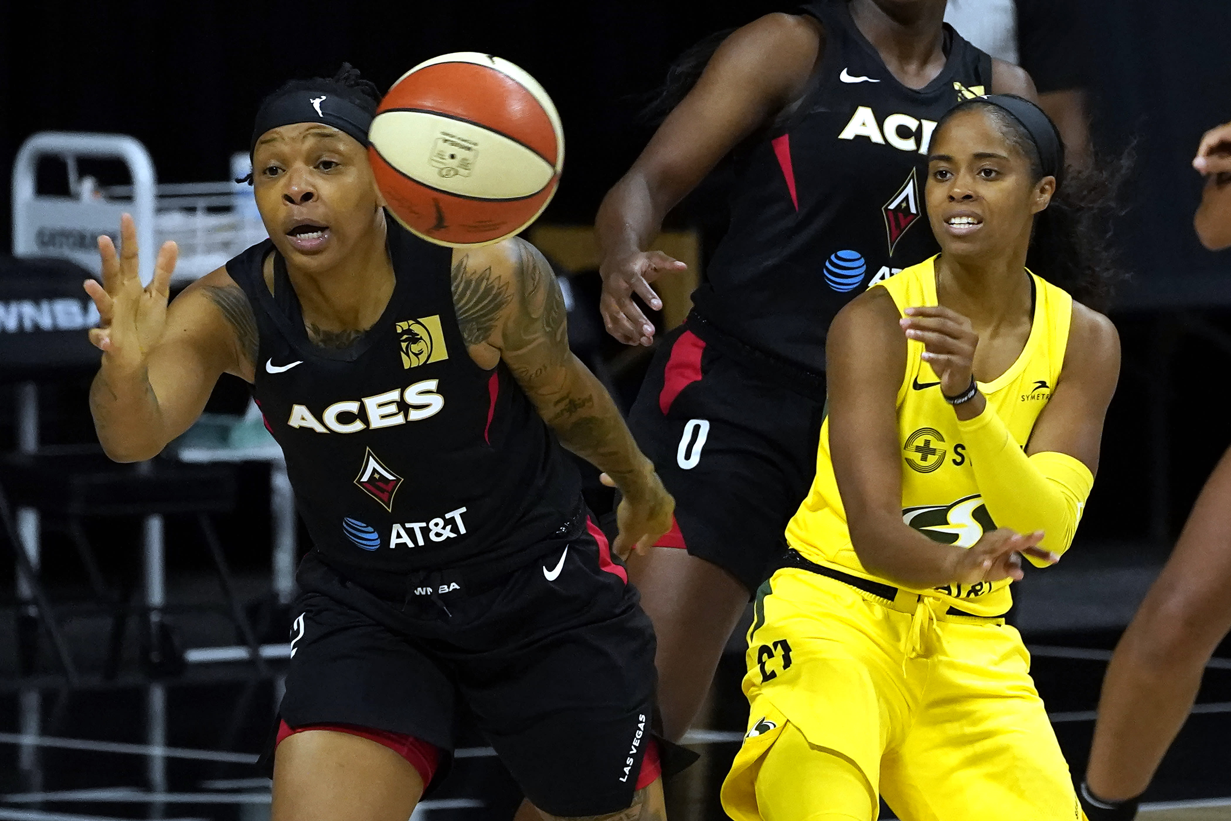 Seattle Storm guard Jordin Canada (21) works against Las Vegas Aces forward Emma Cannon during the first half of Game 1 of basketball's WNBA Finals on Friday, Oct. 2, 2020, in Bradenton, Fla. (AP Photo/Chris O'Meara)