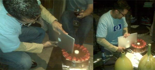 HP exec cuts birthday cake with MacBook Air
