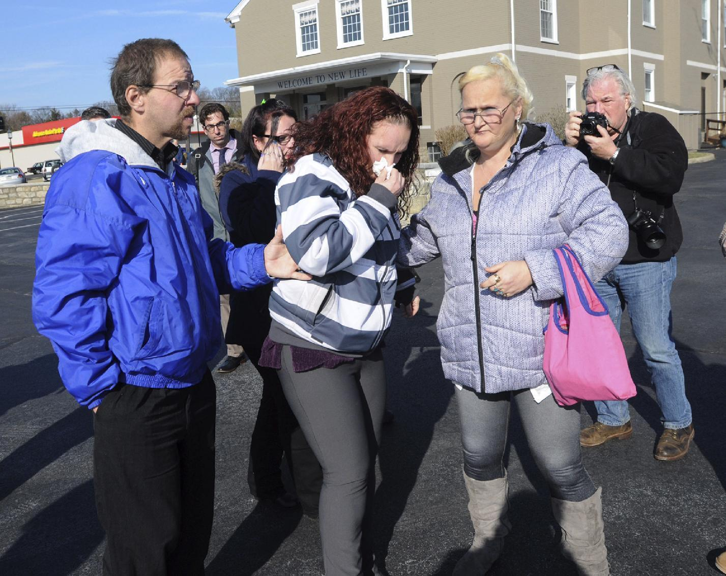 Rodney, left, and Rose Hunsicker, birth parents of Grace Packer, arrive for a memorial service in Glenside, Pa., Monday, Jan. 16, 2017. Friends described Grace, allegedly killed by her adoptive mother and the mother's boyfriend, as a bubbly girl who looked out for lonely classmates at school. (Art Gentile/The Intelligencer via AP)