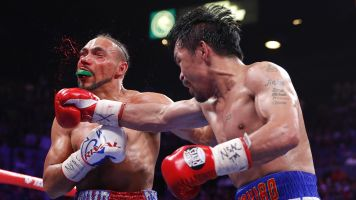 Pacquiao hands Thurman first loss in thriller