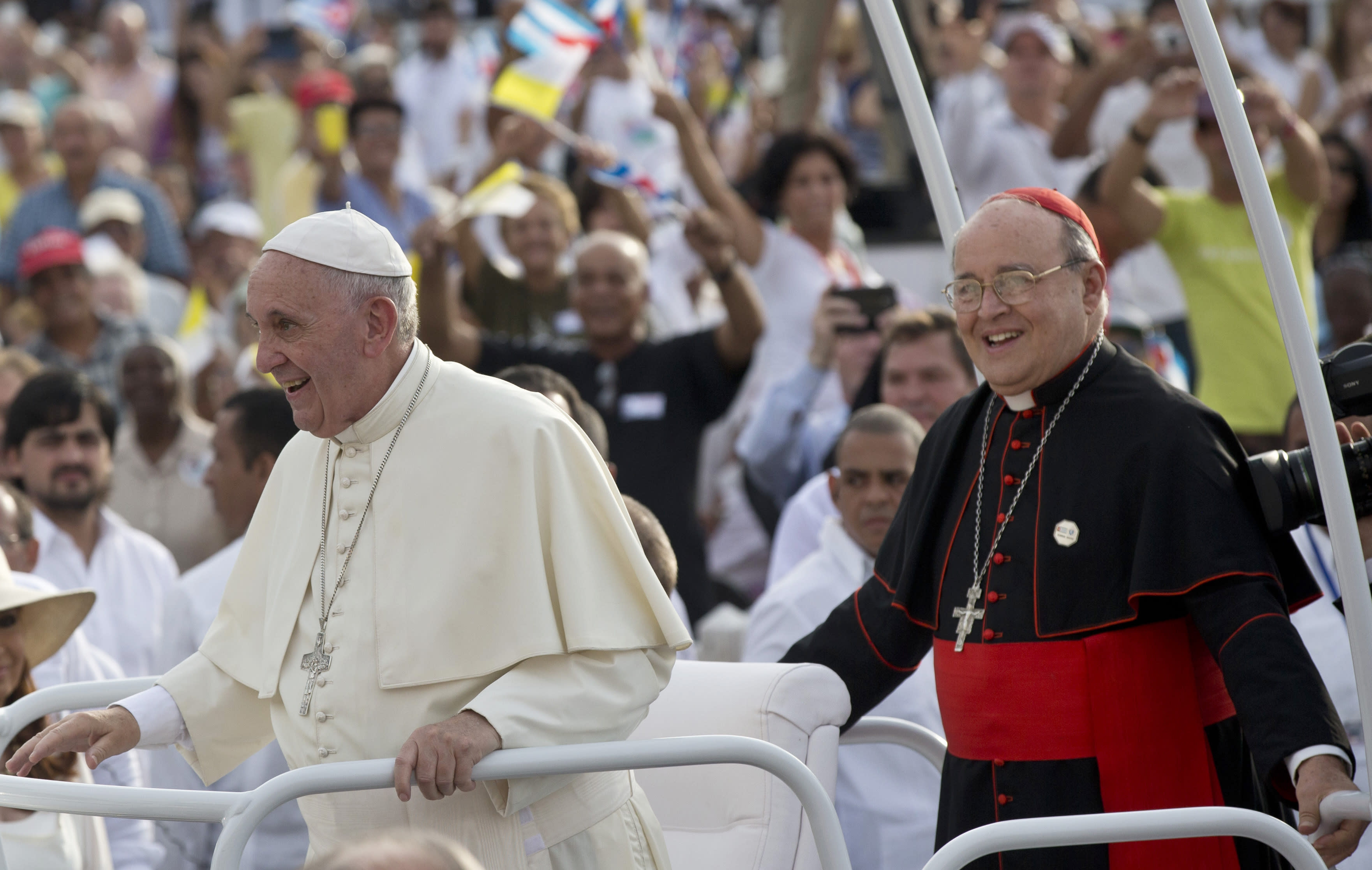FILE - In this Sept. 20, 2015 file photo, Cuba's Cardinal Jaime Ortega, right, accompanies Pope Francis in the popemobile as they arrive for Mass at Revolution Plaza in Havana. Cuba's Roman Catholic Church said Friday, July 26, 2019, the former archbishop of Havana who helped organize the first papal visit to communist Cuba has died. Ortega was 83. (Ismael Francisco/Cubadebate Via AP File)
