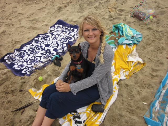 Jackie Vestal and her beloved dog, Maddox, on a beach.