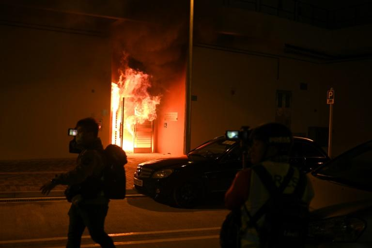 A fire raged at the entrance to one of the buildings earmarked as a virus quarantine centre (AFP Photo/Philip FONG)