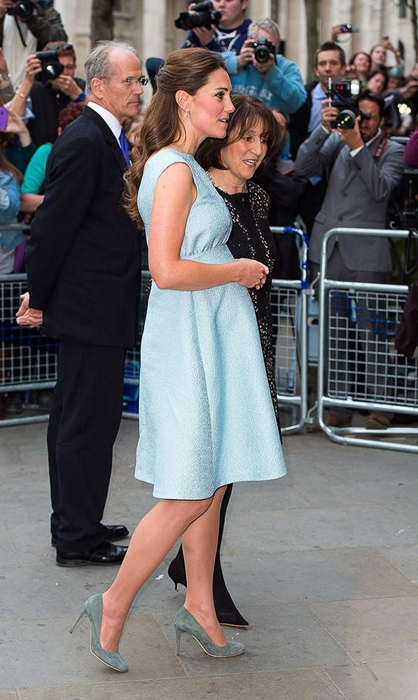 Kate attended an event at the National Portrait Gallery, wearing a '50s-inspired, powder blue Emilia Wickstead dress and grey suede pumps.