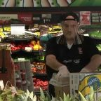 Grocery store owner supplying employees with face shields, masks
