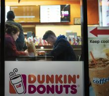 Dunkin' exec takes shot at Starbucks over politics