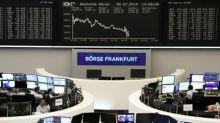 European shares end lower as Fed optimism short-lived; banks outperform