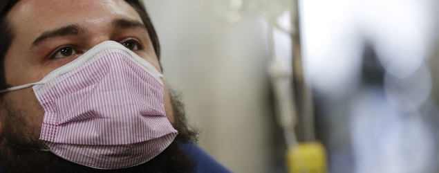 Study: Flu can be spread just by breathing. (AP)
