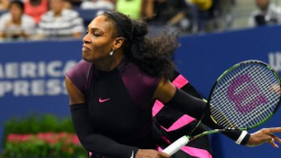 Williams sister act through to Open second round