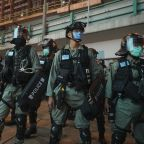 Man held on UK-bound flight on suspicion of stabbing police in Hong Kong protest