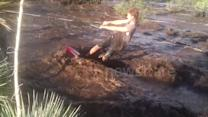 Teen surfs fast-flowing floodwaters in Arizona