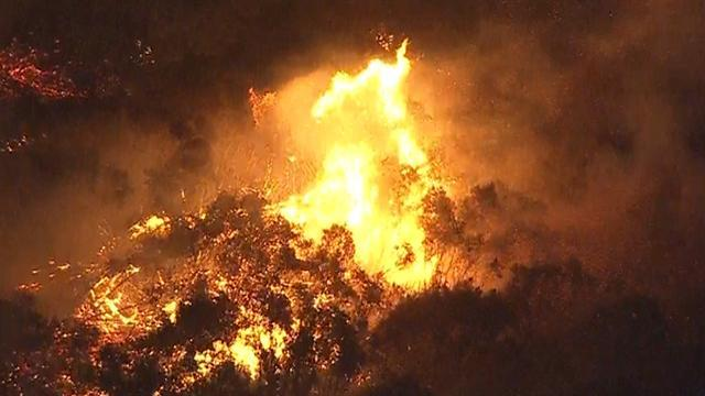 West Coast wildfire fueled by strong winds