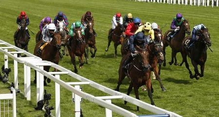 Britain Horse Racing Ladies Day Racegoers photograph Queen's arrival