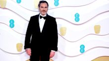 Baftas: Joaquin Phoenix steps out in same suit for third awards show running