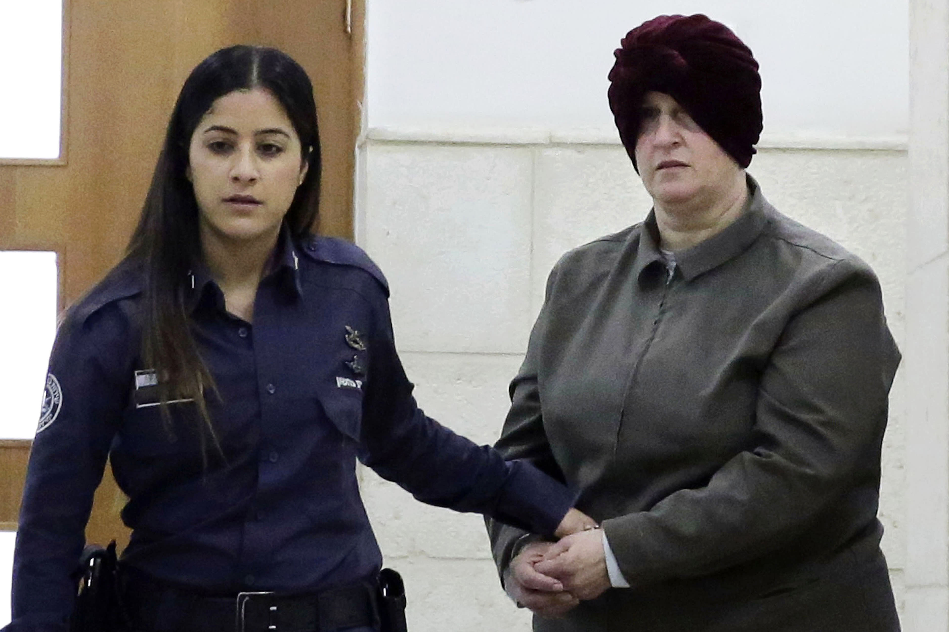 FILE - This Feb. 27, 2018, file photo, Australian Malka Leifer, right, is brought to a courtroom in Jerusalem. An Israeli court on Monday, Sert. 21, 2020 approved the extradition of the former teacher wanted in Australia on charges of child sex abuse, paving the way for her to stand trial after a six-year legal battle. (AP Photo/Mahmoud Illean, File)