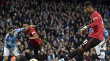 Man United rock City as Liverpool march on
