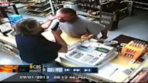 Watch: Liquor store cashier pulls gun on would-be robber