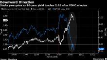 U.S. Stocks End Mixed as Bonds Gain, Dollar Slumps: Markets Wrap