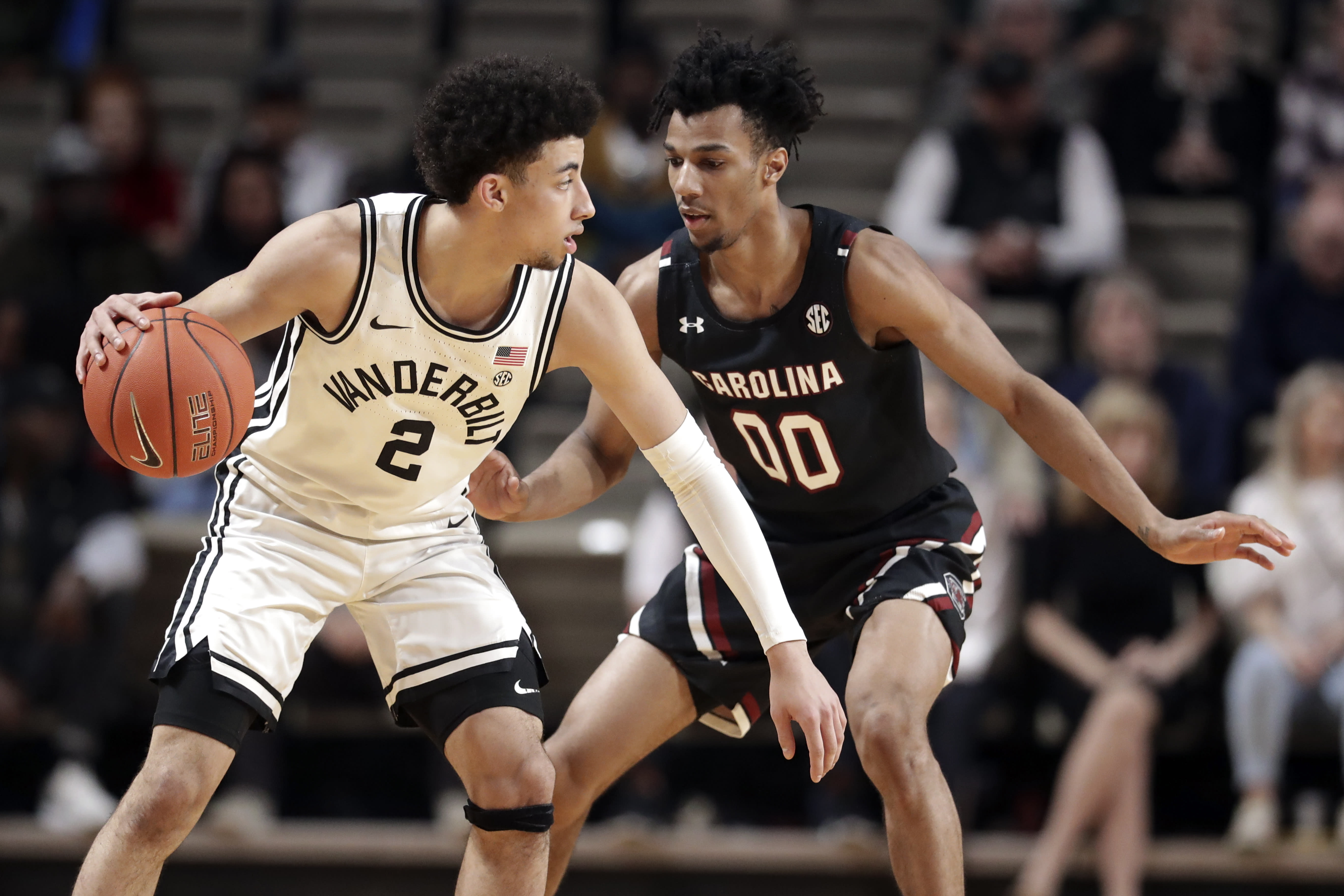 Vanderbilt guard Scotty Pippen Jr. (2) plays against South Carolina's A.J. Lawson (00) in the second half of an NCAA college basketball game Saturday, March 7, 2020, in Nashville, Tenn. Pippen led Vanderbilt with 21 points as they won 83-74. (AP Photo/Mark Humphrey)