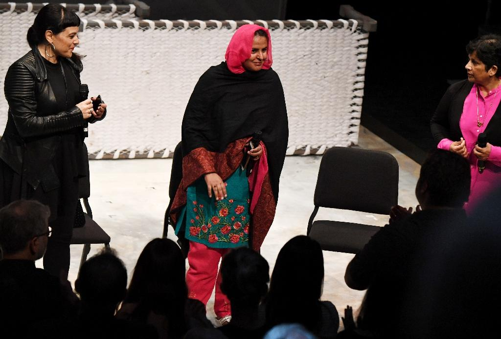 Pakistani human rights activist Mukhtar Mai (C) receives a standing ovation as she takes the stage following performance of the opera 'Thumbprint', at the Roy and Edna Disney/Calarts Theater (REDCAT) in Los Angeles, on June 16, 2017 (AFP Photo/Robyn Beck)