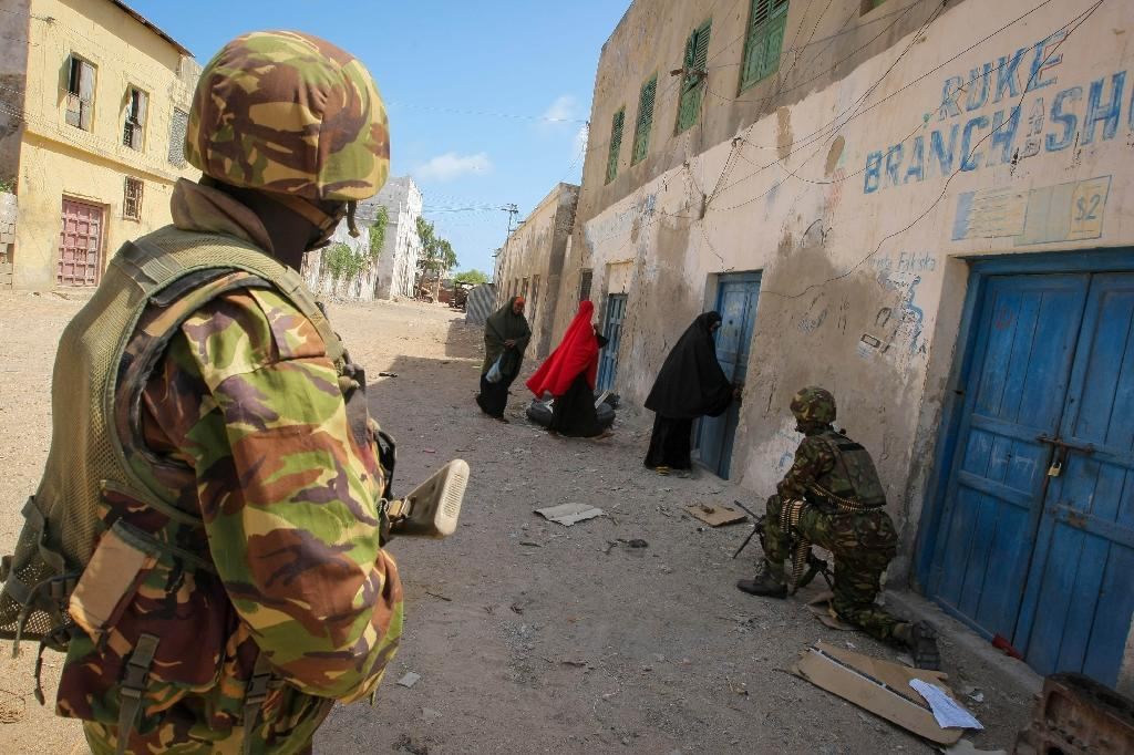 Soldiers of the Kenyan Contingent serving with the African Union Mission in Somalia (AMISOM) stand guard on a street in the centre of the southern Somali port city of Kismayo on October 5, 2012