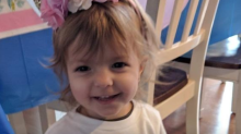 'She doesn't let anything stop her': Parents praise 2-year-old girl battling rare form of ovarian cancer