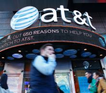 Clinton voices concern over AT&T-Time Warner mega-deal
