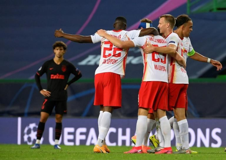 Captain Yussuf Poulsen (R) leads the celebrations after RB Leipzig beat Atletico Madrid 2-1 on Thursday to reach the semi-finals of the Champions League.