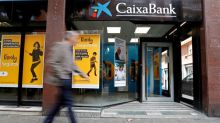 Spain's Caixabank net profit plunges over 80% on higher provisions
