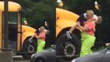 Photo of school coach carrying student in the rain is why teachers are heroes