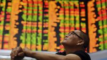 Asian shares turn lower after strong day on Wall Street