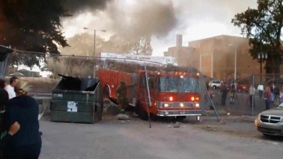Fire truck crashes into fence