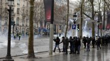 Tear gas on Champs-Elysees but fewer Paris protesters seen
