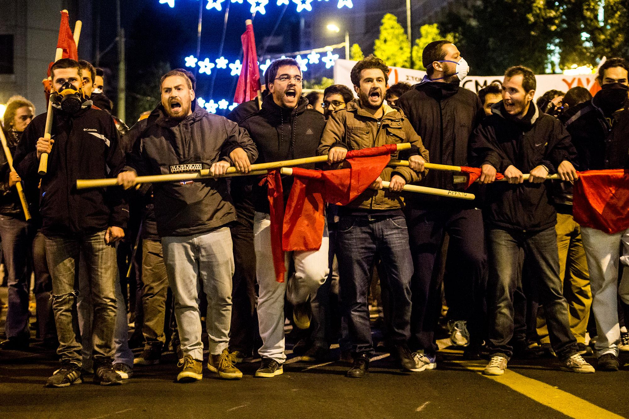 <p>Leftists march and shout slogans during a protest against President Barack Obama's visit in Athens, between riot policemen and protesters on Nov. 15, 2016. (Kostas Pikoulas/Pacific Press/LightRocket via Getty Images) </p>
