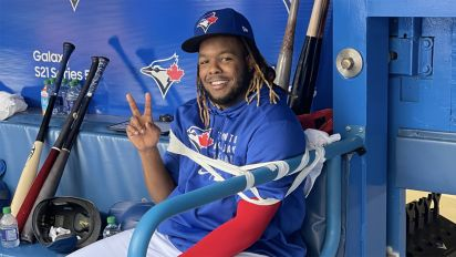This is one way to keep Vladdy Jr. calm in dugout