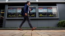Asian shares buckle to European woes, Saudi anxieties
