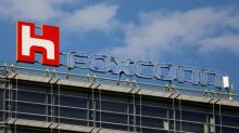 Foxconn aims to resume half of output in virus-hit China by month-end: source