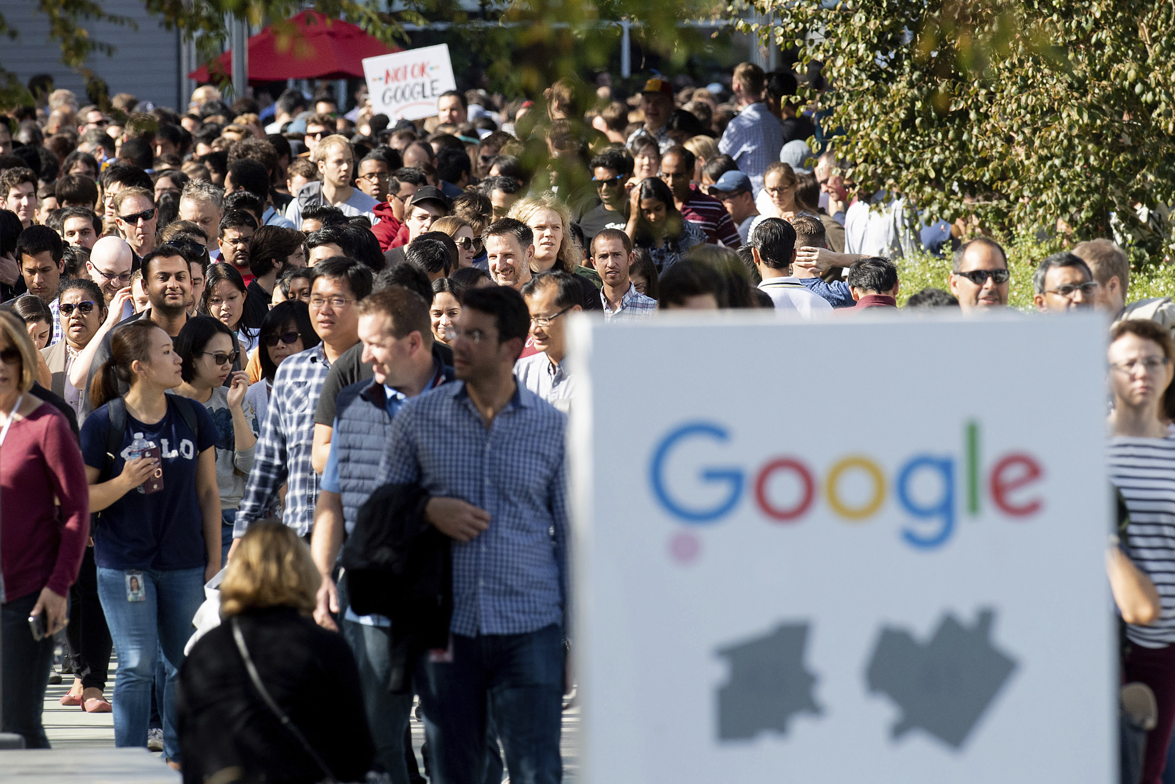 <p>Workers leave Google's Mountain View, Calif., main quad on Thursday, Nov. 1, 2018, after some Google employees walked off the job Thursday in a protest against what they said is the tech company's mishandling of sexual misconduct allegations against executives. (Photo: Noah Berger/AP) </p>