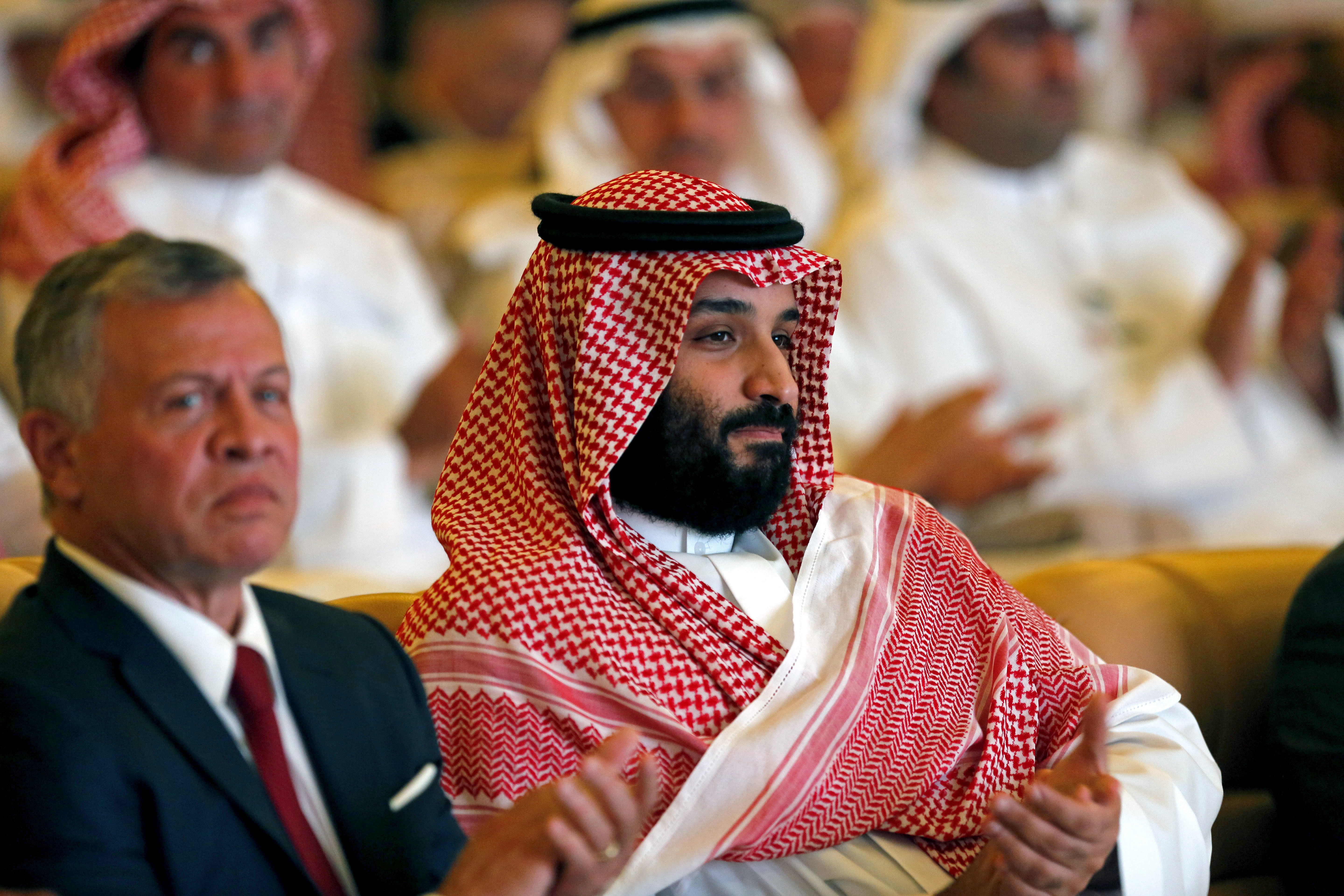 Saudi Crown Prince, Mohammed bin Salman, right, and Jordan's King Abdullah II, applaud at the Future Investment Initiative conference, in Riyadh, Saudi Arabia, Tuesday, Oct. 23, 2018.The high-profile economic forum in Saudi Arabia is the kingdom's first major event on the world stage since the killing of writer Jamal Khashoggi at the Saudi Consulate in Istanbul earlier this month. (AP Photo/Amr Nabil)